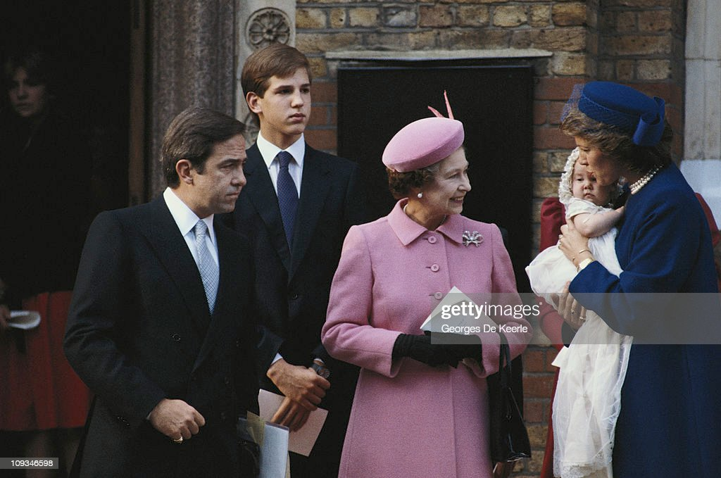 Ex-King Constantine of Greece with Queen Anne-Marie and their daughter Princess Theodora at her christening in London. In the centre is Queen Elizabeth II of Great Britain, the baby's godmother. Prince Pavlos of Greece stands behind.