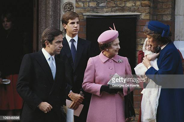 Ex-King Constantine of Greece with Queen Anne-Marie and their daughter Princess Theodora at her christening in London. In the centre is Queen...