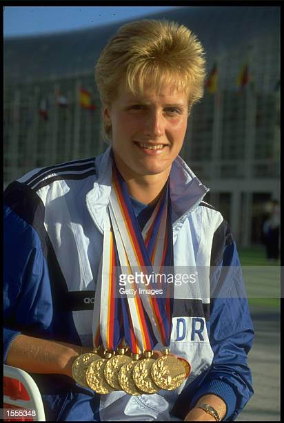 Kristin Otto of East Germany is photographed displaying the six gold medals that she won at the 1988 Seoul Olympics. She is the first woman to win...