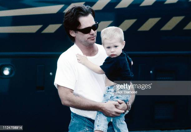 Singer/Songwriter John Mellencamp and Son Hud Mellencamp backstage during Farm Aid at William Brice Stadium in Columbia SC on October 12 1996