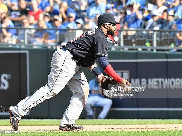 Cleveland Indians designated hitter Carlos Santana throws to Cleveland Indians starting pitcher Josh Tomlin for an out during a MLB American League...