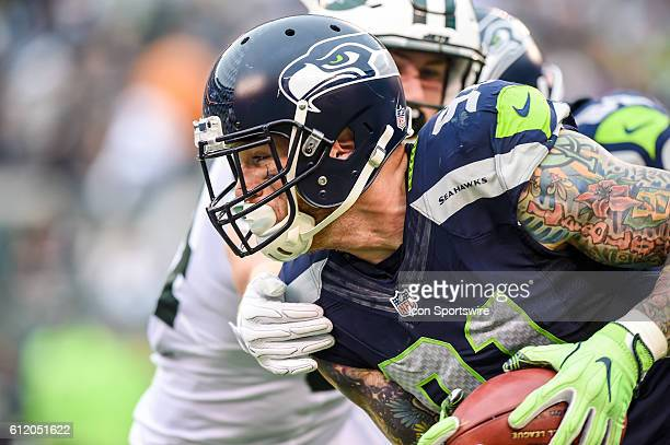 Seattle Seahawks Linebacker Cassius Marsh runs the ball during the New York Jets versus the Seattle Seahawks at MetLife Stadium in East Rutherford NJ