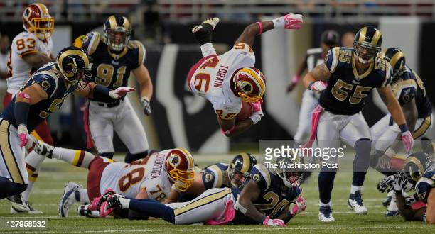Washington Redskins running back Ryan Torain leaps over a heap of players for a 3rd down gain as the Washington Redskins defeat the St Louis Rams 17...