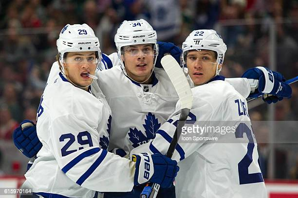 Toronto Maple Leafs right wing William Nylander center Auston Matthews and defenseman Nikita Zaitsev celebrate after Matthews scored on the powerplay...