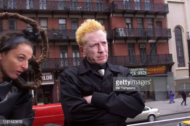 John Lydon aka Johnny Lydon of the Sex Pistols and Public Image Limited and Johnny's stepdaughter Ari Up of the Slits ride a bus in October 2000 in...