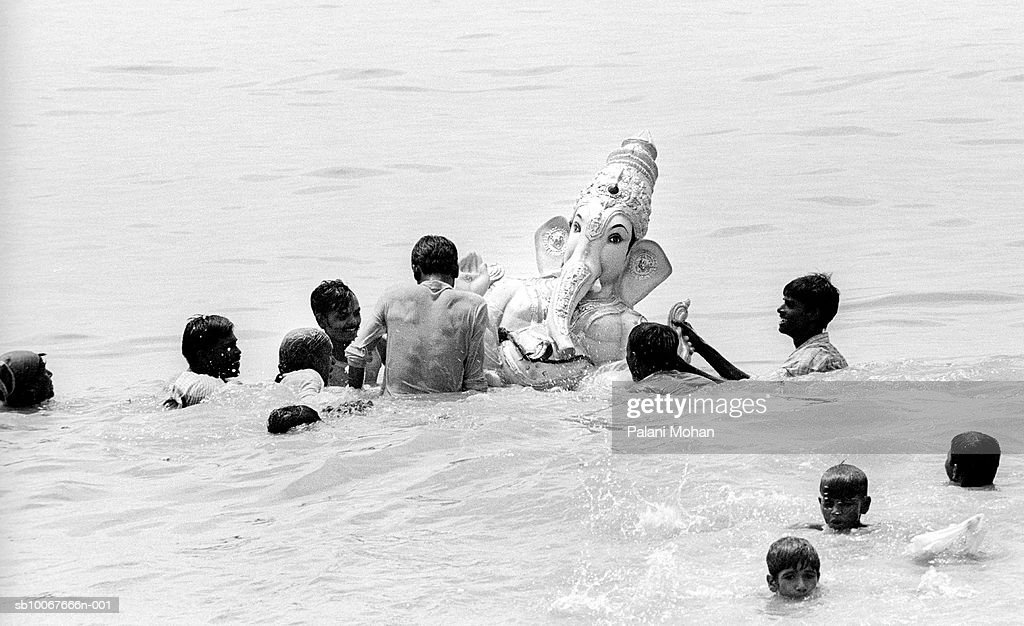 India, Mumbai, statue of Lord Ganesha is immersed in ocean by devotees