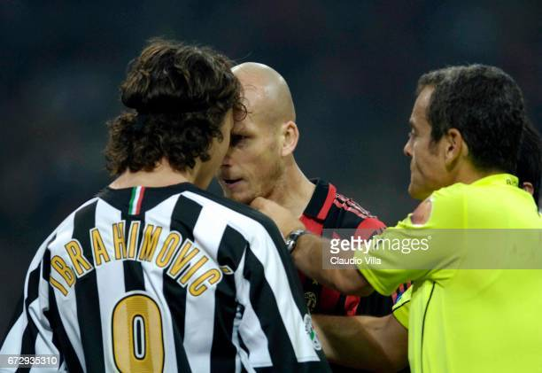29 October 2005 Ibrahimovic of Juventus and Jaap Stam of Milan compete for the ball during the 10th Serie A round league match played between Milan...