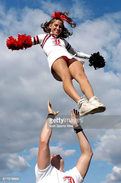 A Louisville large coed squad cheerleader performs on the sidelines as the host Cardinals defeated Middle Tennessee State 4223 at Papa Johns Cardinal...