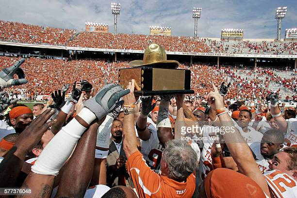 October 2008 - Coach Mack Brown of the Texas Longhorns holds up the Golden Hat trophy after the Texas 45-35 win over Oklahoma at the Red River...