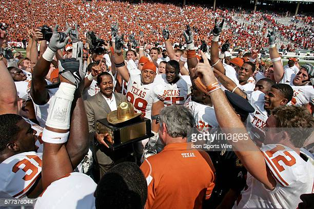 October 2008 - Coach Mack Brown of the Texas Longhorns is presented with the Golden Hat trophy after the Texas 45-35 win over Oklahoma at the Red...