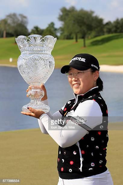 JiYai Shin holds the championship trophy after winning the ADT Championship on the Trump International Golf Club in West Palm Beach Fl