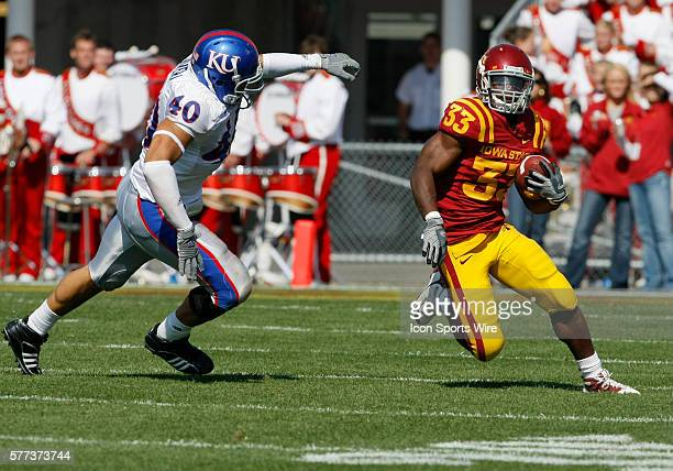 Kansas defender Mike Rivera puts pressure on Iowa State Cyclones runningback Alexander Robinson as he rushes for yards in the first half of play at...
