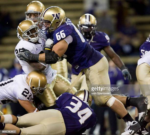 University of Washington defensive end Daniel Te'oNesheim takes down University of Notre Dame running back Jonas Gray during the second half of play...
