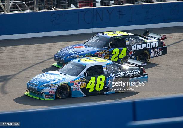 Jeff Gordon and Jimmie Johnson during the NASCAR Sprint Cup Series Pepsi 500 at the Auto Club Speedway in Fontana CA