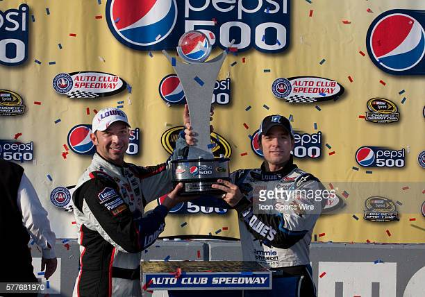 Jimmie Johnson driver of Lowe's / Jimmie Johnson Foundation Chevrolet and Crew Chief Chad Knaus celebrate after winning the NASCAR Sprint Cup Series...