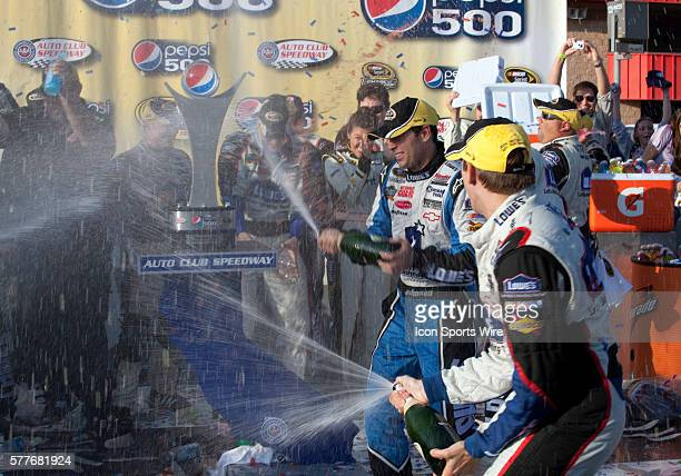 Jimmie Johnson driver of the Lowe's / Jimmie Johnson Foundation Chevrolet celebrates after winning the NASCAR Sprint Cup Series Pepsi 500 at the Auto...