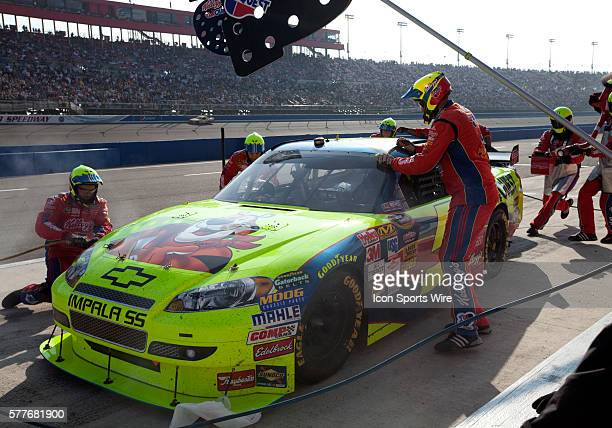 Mark Martin driver of the Kellogg's / Carquest Chevrolet makes a pit stop during the NASCAR Sprint Cup Series Pepsi 500 at the Auto Club Speedway in...