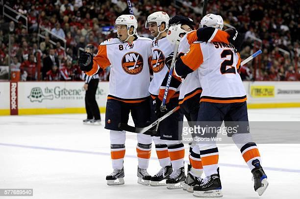New York Islanders center Frans Nielsen is congratulated by defenseman Bruno Gervais after scoring his second goal of the 2nd period as defenseman...