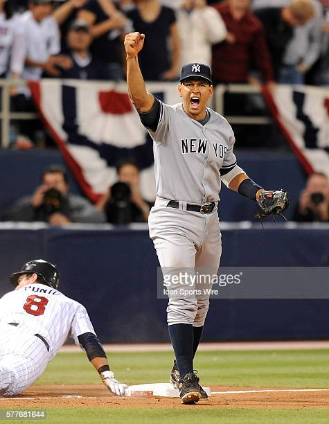 NY Yankees Vs Minnesota Twins Gm3 ALDS The NY Yankees first baseman Mark Teixeira throws out Punto at third Alex Rodriguez makes the tag and...