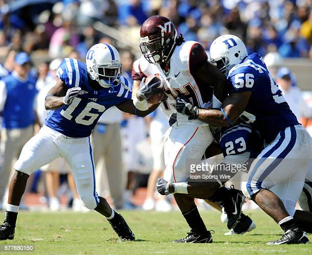 Virginia Tech tailback Ryan Williams looks for running room as Duke's Chris Rwabukamba #23 Catron Gainey and Damian Thornton defend during the...