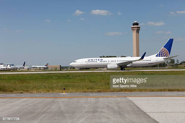 A Boeing Company 737924 extended range jet bearing United Airlines livery and the Continental Airlines logo arrives following the inaugural flight...