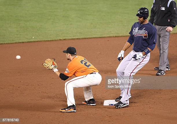 Atlanta Braves first baseman Derrek Lee goes into second base with a double as San Francisco Giants second baseman Freddy Sanchez catches the ball as...