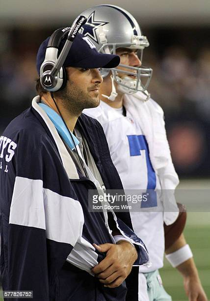 Dallas Cowboys quarterback Tony Romo looks on with quarterback Stephen McGee as he is out with broken collarbone during the Dallas Cowboys vs the New...