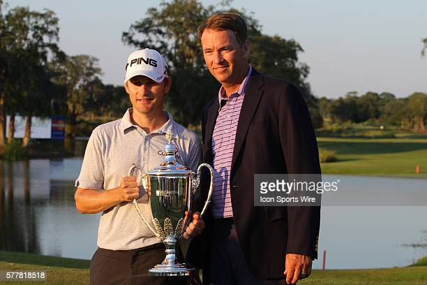Heath Slocum with his trophy and Davis Love III after The McGladrey Classic held at the Sea Island Golf Club in St. Simons Island, GA.