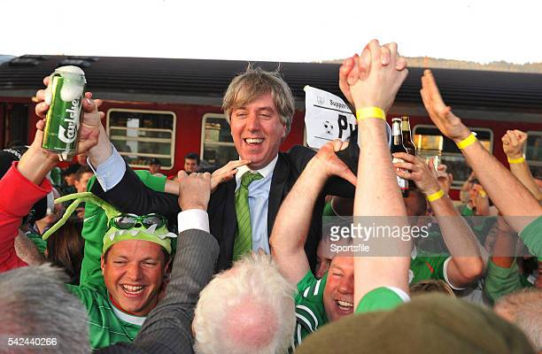 October 2010; Republic of Ireland supporters with FAI chief executive John Delaney at Zilina train station after travelling on a train from...