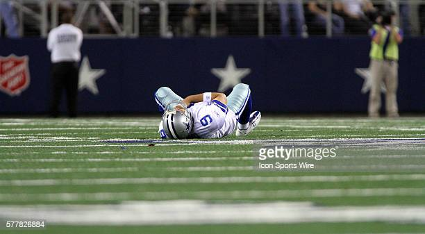 With no one in yards of him Dallas Cowboys quarterback Tony Romo lays on the ground injured during the first half of the Dallas Cowboys vs the New...