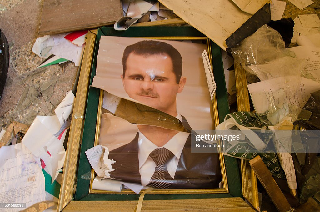 CONTENT] October 2012. Poster of Bashar al-Assad is destroyed in the town hall of Salma.