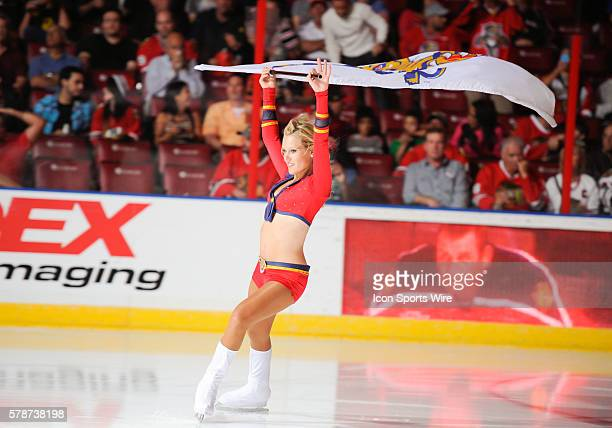 Florida Panthers ice dancer skates and performs on the ice with a flag during the NHL hockey game between the Chicago Blackhawks and the Florida...