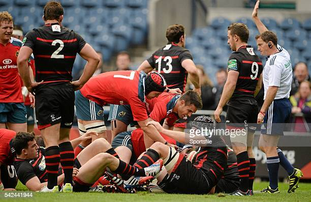 12 October 2013 Munster's Mike Sherry hidden is congratulated by teammates Niall ronan and Conor Murray on scoring his side's second try signalled by...