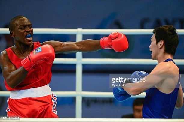 20 October 2013 Souleymane Cissokho France left exchanges punches with Yasuhiro Suzuki Japan during their 69Kg preliminary bout AIBA World Boxing...