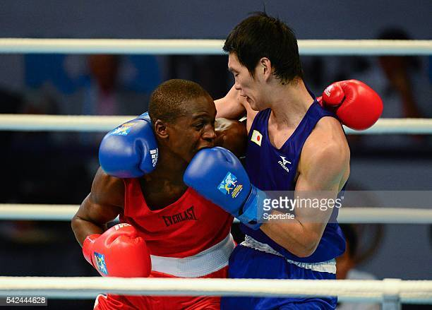 20 October 2013 Souleymane Cissokho left France exchanges punches with Yasuhiro Suzuki Japan during their 69Kg preliminary bout AIBA World Boxing...