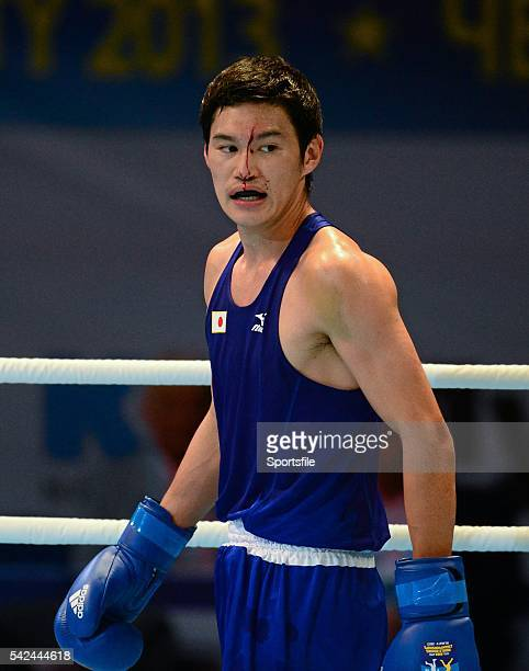 20 October 2013 Yasuhiro Suzuki Japan after receiving an injury during his 69Kg preliminary bout with Souleymane Cissokho France AIBA World Boxing...