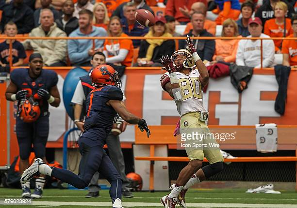 Florida State Seminoles wide receiver Rashad Greene makes a catch in front of Syracuse Orange cornerback Julian Whigham during ncaa football game...