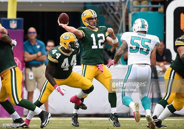 Green Bay Packers Quarterback Aaron Rodgers [7705] passes against the Miami Dolphins in Green Bay's 2724 victory at Sun Life Stadium Miami Florida