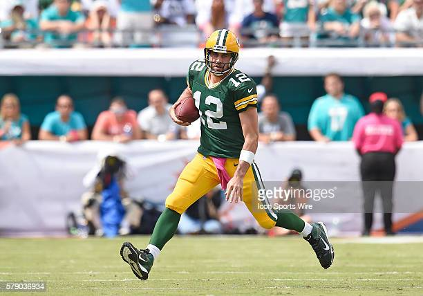 Green Bay Packers Quarterback Aaron Rodgers [7705] plays against the Miami Dolphins in Green Bay's 2724 victory at Sun Life Stadium Miami Florida