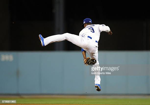 Los Angeles Dodgers Second base Dee Gordon [7422] leaps and makes a catch between first and second base during game 2 of the NLDS between the St...