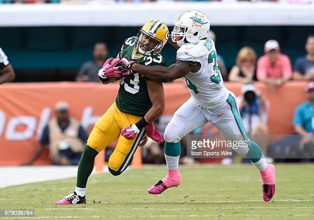 Miami Dolphins Running Back Damien Williams [12525] tackles Green Bay Packers Cornerback Micah Hyde [18593] in Green Bay's 27-24 victory at Sun Life...