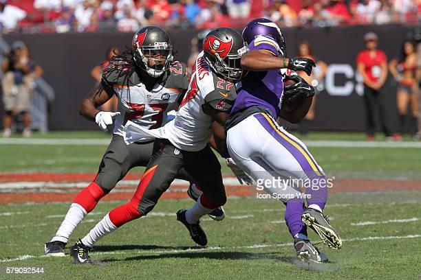 Tampa Bay Buccaneers cornerback Johnthan Banks hits Minnesota Vikings wide receiver Charles Johnson as Tampa Bay Buccaneers strong safety Mark Barron...