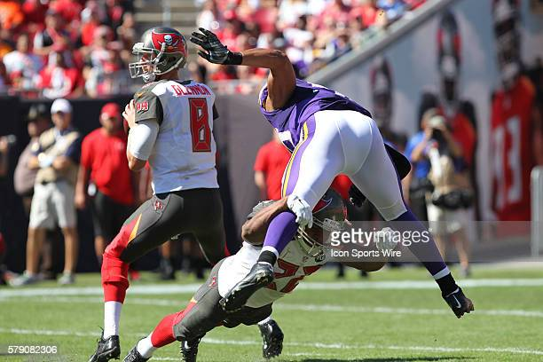 Tampa Bay Buccaneers running back Doug Martin blocks Minnesota Vikings outside linebacker Anthony Barr as Tampa Bay Buccaneers quarterback Mike...