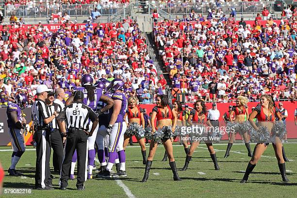 The Tampa Bay Buccaneers cheerleaders dance a few feet away from the Vikings huddle in the 4th quarter of the NFL regular season game between the...