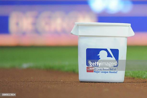A bucket of baseballs sits on the field before a game between the Chicago Cubs and Milwaukee Brewers at Miller Park in Milwaukee WI