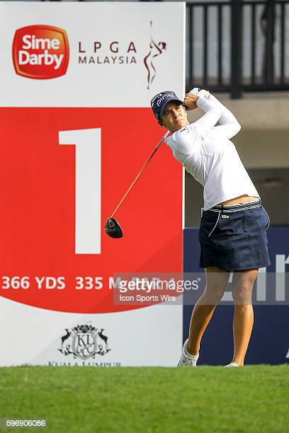 Azahara Munoz of Spain play a shot during the first round of the 2015 Sime Darby LPGA Malaysia at Kuala Lumpur Golf and Country Club in Kuala Lumpur,...