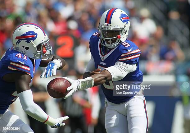 Buffalo Bills Quarterback Tyrod Taylor hands off to Buffalo Bills Running Back Cierre Wood during the NFL football game between the Buffalo Bills and...