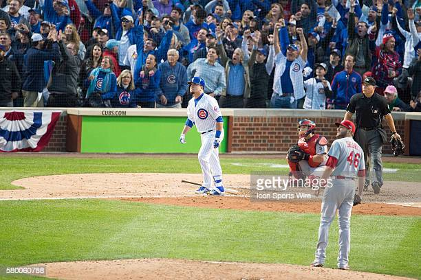 Chicago Cubs left fielder Kyle Schwarber and fans watch Schwarber's home run in game 4 of the NLDS in a game between the St Louis Cardinals and the...