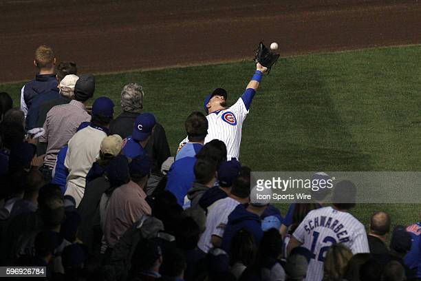 Chicago Cubs left fielder Kyle Schwarber catches a fly ball hit by New York Mets first baseman Lucas Duda in the first inning of game 3 action of the...