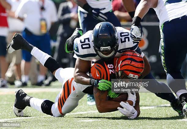 Cincinnati Bengals wide receiver Marvin Jones battles pressure from Seattle Seahawks' KJ Wright during the first half of play at Paul Brown Stadium...